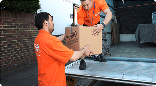A team of two removalists loading a van
