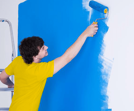 Pro painting a wall