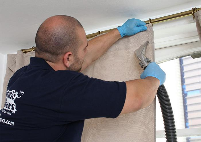 Fantastic expert cleaning a curtain