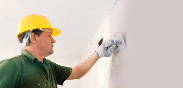 Fantastic Handyman plastering a wall