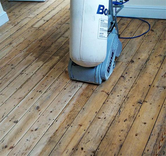 Wood floor sanding in progress