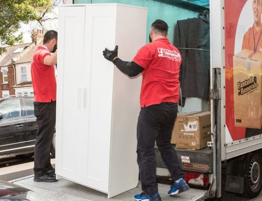 removal team loading a wardrobe
